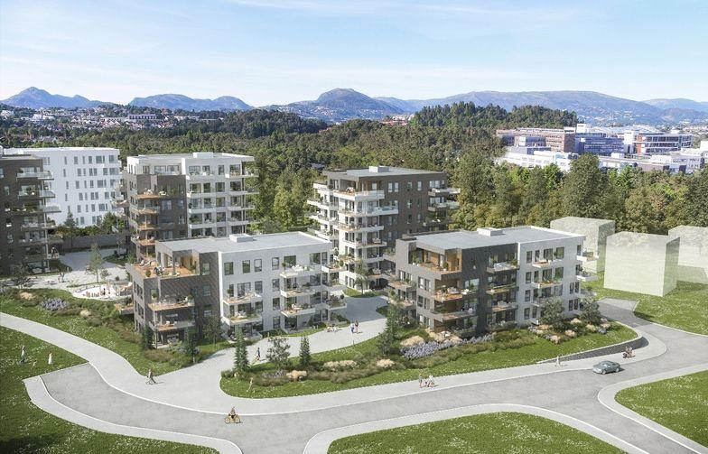 Bostäderna är fördelade på fem byggnader som förbinds med en underjordisk parkeringsanläggning.