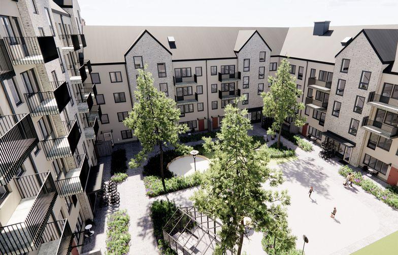 Kvarteret Caramel har varierade fasade med mur respektive puts och även taken varieras med plåt och sedum. Bild: Sweco Architects.